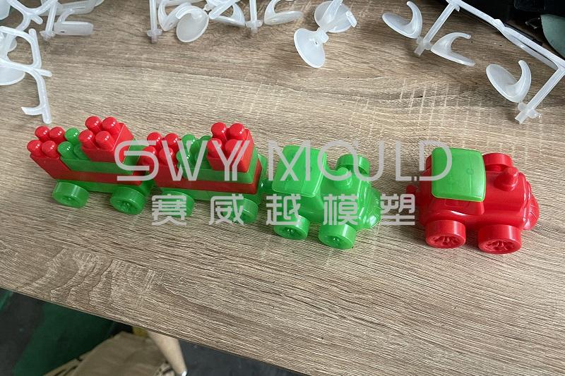 T1 de molde de ladrillos de juguete de plástico